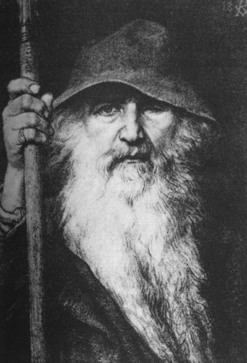 One-eyed old man wearing dark hood and cloak with long walking stick in black and white