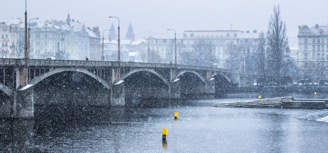Prague, Czech Republic snow falling over city, bridge and Vltava river photo by RichardLey on https://pixabay.com/en/snow-bridge-winter-snowy-river-1749769/