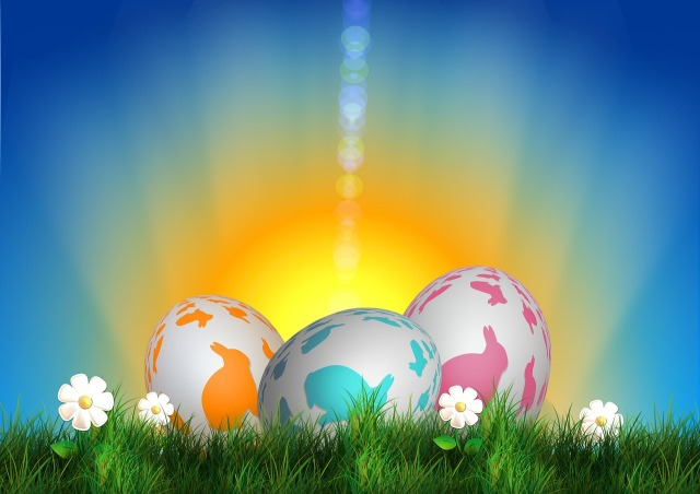Colored eggs with rabbit silhouettes on spring green grass with a rising sun in the background by geralt on Pixabay at https://pixabay.com/en/celebration-color-decoration-grass-70199/