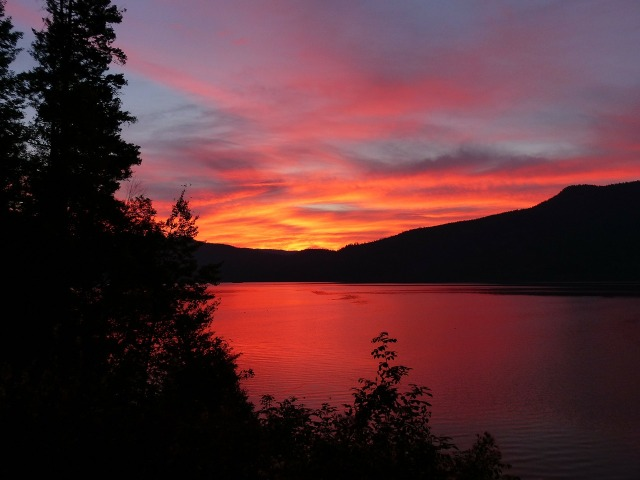 Glowing sunrise at dawn over Canim Lake in British Columbia, Canada by werner22brigitte on Pixabay at https://pixabay.com/en/glowing-sun-rise-canim-lake-216042/