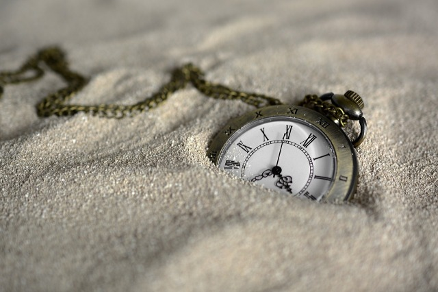 Pocket watch half covered by the sands of time, photograph by annca at https://pixabay.com/en/pocket-watch-time-of-sand-time-3156771/