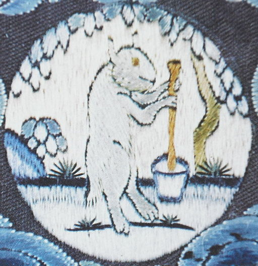 A medallion on an embroidered 18th century imperial robe (above the head of a dragon - not shown), with the White Hare of the Moon, at the foot of a cassia tree, making elixir of immortality from Wikimedia at https://commons.wikimedia.org/wiki/File:White-Rabbit-making-elixir-of-immortality.jpg
