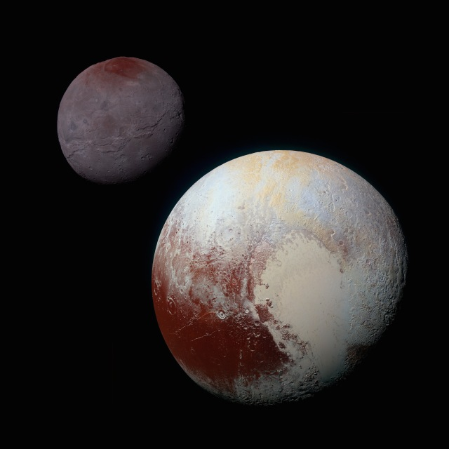 This composite of enhanced color images of Pluto (lower right) and Charon (upper left), was taken by NASA's New Horizons spacecraft as it passed through the Pluto system on July 14, 2015. Credit: NASA/JHUAPL/SwRI https://www.nasa.gov/image-feature/charon-and-pluto-strikingly-different-worlds