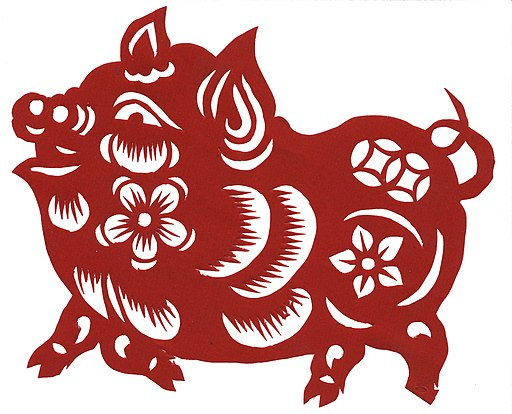 Paper cut image of pig for celebrating the Chinese New Year of the Pig by Fanghong 18 February 2007 shared per dual-license under the GFDL and CC-By-SA-2.5 license from https://commons.wikimedia.org/wiki/File:Chinese_paper_cutting-Pig.jpg